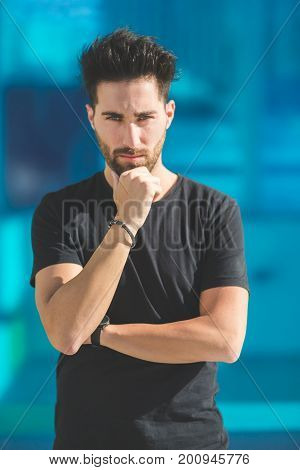 Young Serious Man Propping Chin On Hand