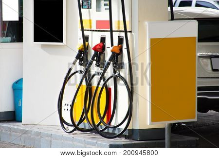Colorful Petrol pump filling nozzles.Gas pump nozzles in a service station