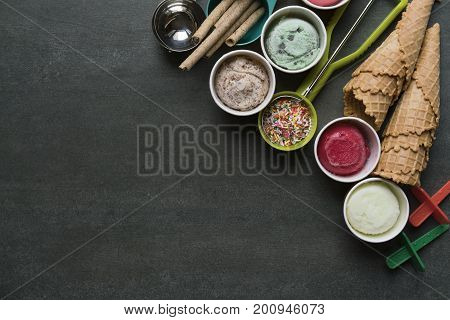 Top view of Ice cream flavors in cup and topping sweet and dessert food concept