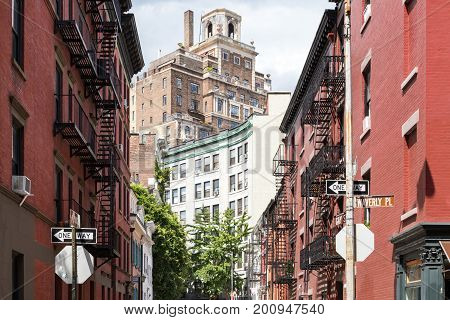 Historic buildings at the intersection of Gay Street and Waverly Place in the Greenwich Village neighborhood of Manhattan in New York City NYC