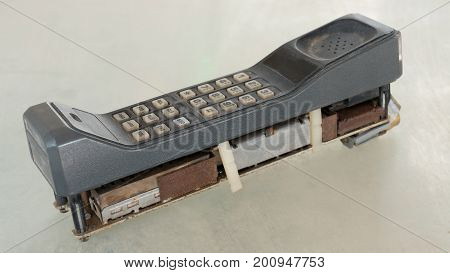First Generation Style Of Cellular Mobile Phone With 1G Or 2G On Old Table With Vintage Tone Style.