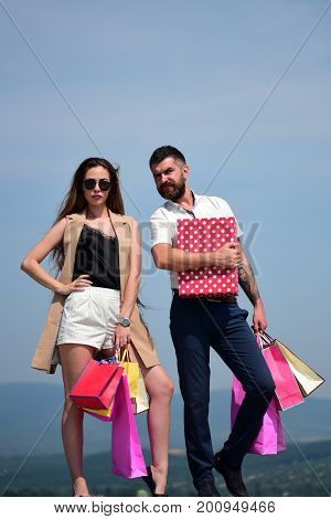 Shopping And Fashion Concept. Girl And Guy With Serene Faces
