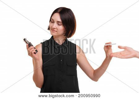 A young woman showing preference to a less harmful vaping device than smoking. Portrait of a girl deciding between a trendy electronic cigarette and a classic one isolated on a white background.