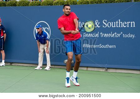 Mason Ohio - August 15 2017: Nick Kyrgios in a first round match at the Western and Southern Open tennis tournament in Mason Ohio on August 15 2017.
