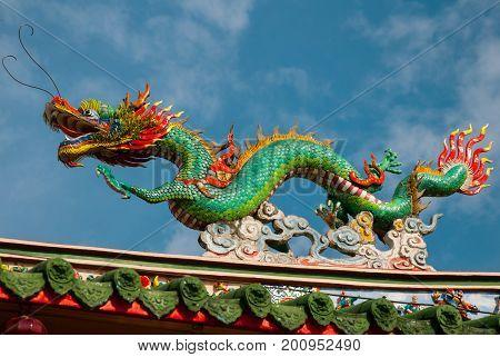 Multi-colored Dragons Against A Blue Sky. Chinese Temple Tua Pek Kong. Miri City, Borneo, Sarawak, M