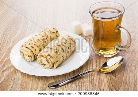 Two Pancakes With Stuffed In Plate, Sugar, Cup Of Tea
