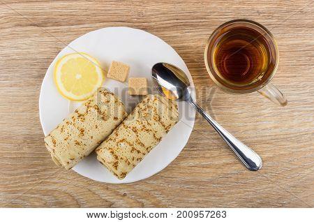 Pancakes With Stuffed, Lemon, Sugar, Teaspoon In Plate And Tea