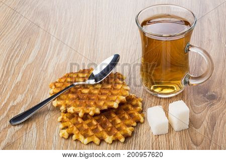 Two Waffles, Cup Of Tea, Lumpy Sugar And Teaspoon