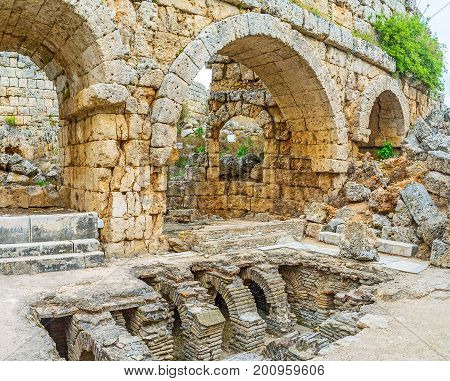 The Roman Baths of Perge among the ruins of ancient Anatolian city, Antalya, Turkey.
