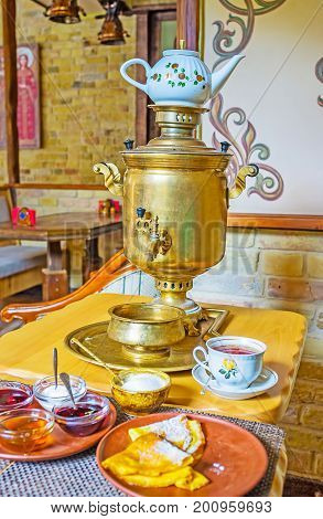 Traditional Samovar With Sweet Pancakes