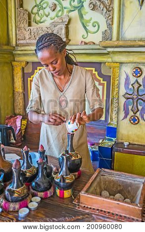 Preparing Ethiopian Coffee In Traditional Boiling Pot