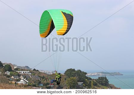 Paraglider launching from Carbis Bay in Cornwall