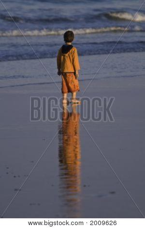 Boy In Orange At Sunset