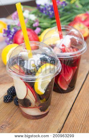 Summer drink, Sangria-white and red. Fruits, apples, lemon, blackberries