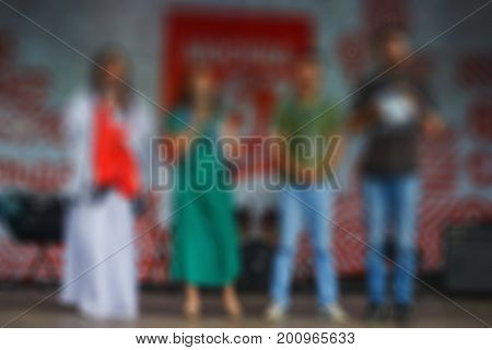 Beautiful blurred background of people. Theatrical performance on stage
