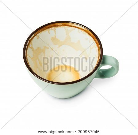 Empty blue coffee cup with cappucino remains closeup isolated on white background. Cafe and bar, barista art concept.