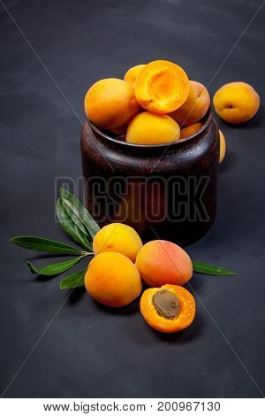 Apricot and halve with stone on dark background