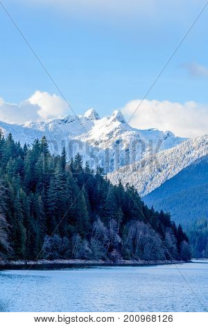 Snow Mountains and Capilano Lake in Vancouver British Columbia Pacific Northwest.