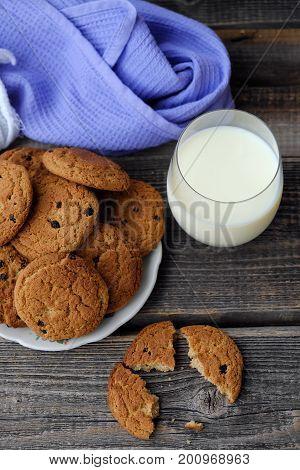 Homemade oatmeal cookies with raisins and milk