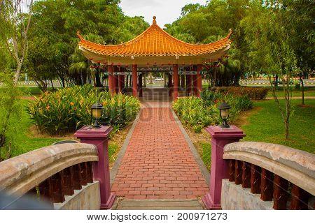 The Bridge And The Chinese Pavilion. Miri City Fan Park, Borneo, Sarawak, Malaysia