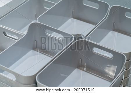 Stack Of Grey Plastic Trays Arrangement For Background.