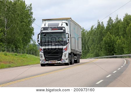 ORIVESI FINLAND - JULY 6 2017: Customized white Volvo FH semi truck of HCO Logistics transports goods along highway in Central Finland at summer.
