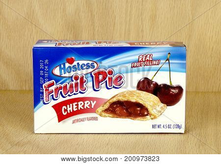 RIVER FALLS,WISCONSIN-AUGUST 21,2017: A Hostess brand cherry pie box with a wood background.