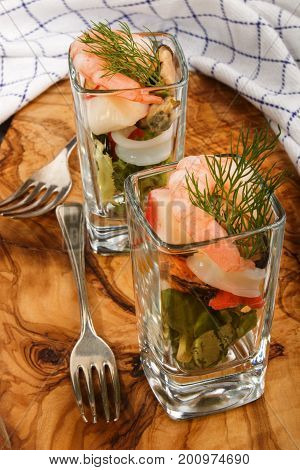 fresh seafood mic salad with dill in a shot glass