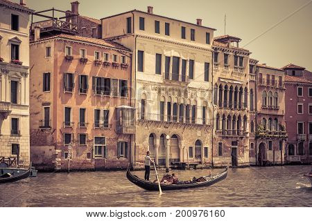 Venice, Italy - May 18, 2017: The gondola with tourists floats along the Grand Canal. Gondola is the most attractive tourist transport in Venice.