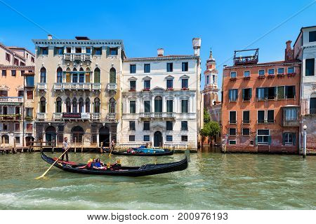 Venice, Italy - May 19, 2017: The gondola with tourists floats along the Grand Canal. Gondola is the most attractive tourist transport in Venice.