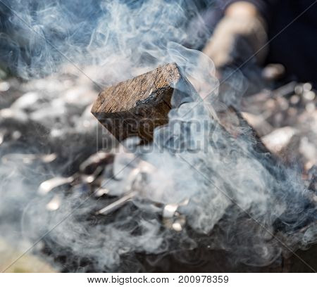 White thick smoke from smoldering firewood close-up