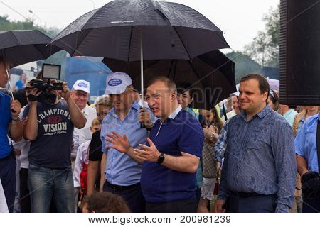 Adygea Russia - August 19 2017: The head of the Republic of Adygea Murat Kumpilov in the composition of the government delegation at the festival of Adyghe cheese in Adygea