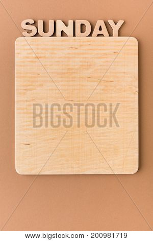 Word Sunday with blank wooden board. Timetable, day of week, to-do-list, time management concept