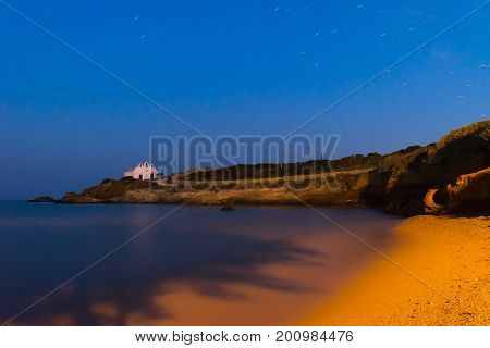 Pirgaki village with the local church at Paros island in Greece during the blue hour.