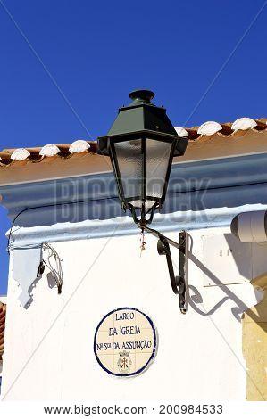 Querenca Algarve Portugal - October 10 2014 : Lantern on the side of a building in Querenca in the Serra de Monchique mountain range of the Algarve