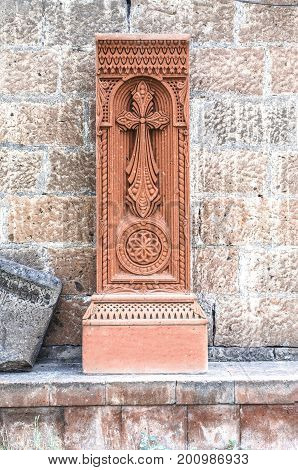 Stone cross made of red tuff at the Church of the Martyr St. Hripsime in Echmiadzin