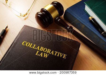 Collaborative law on a desk and gavel.