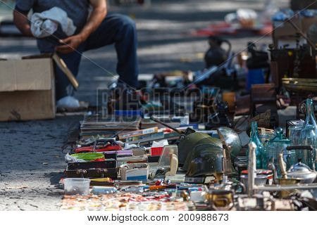 Traders Of Flea Market Having A Lot Of Vintage Cameras, Souvenirs, Toys And Retro Staff For The Cust