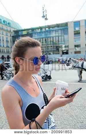 Girl Using Smartphone At City Street