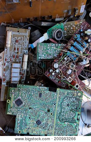 Background With Old Rare Electronic Components Randomly Decomposed