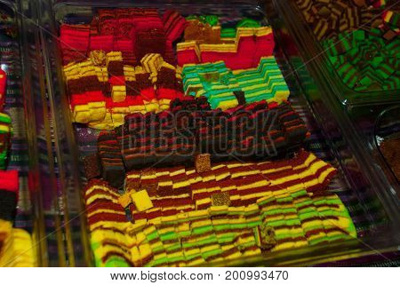 Traditional Mixed Colors Sweet Sponge Cake. An Unusual And Delicious Dessert. Borneo, Sarawak, Malay