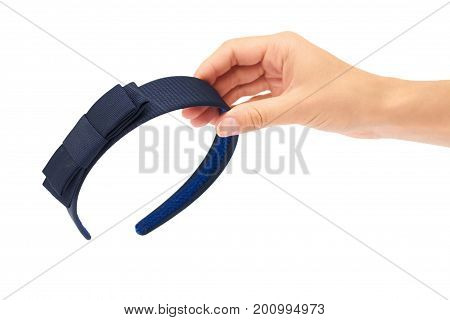 Hand of a woman holding head band isolated on white background.