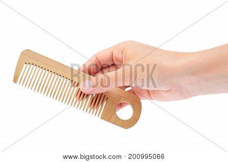 Hand holding hair brush isolated on white background.