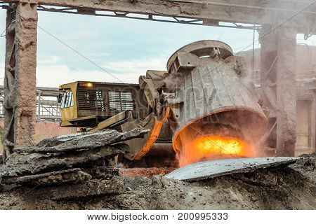 Unloading of hot slag by truck transporter to slag dump. Waste management metallurgical industry.