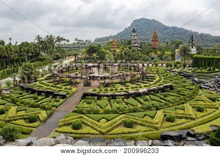 THAILAND, PATTAYA, MARCH, 10, 2015 - Landscape of tropical park of Nong Nooch - botanical garden and tourist attraction, wildlife conservation project in Pattaya, Chonburi Province, Thailand