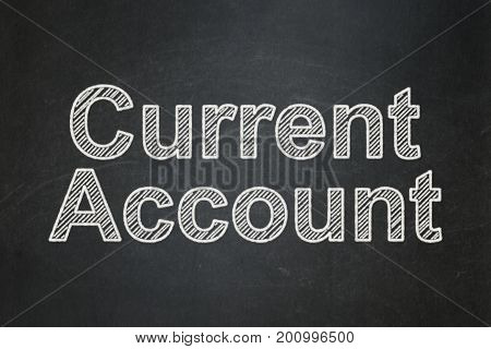 Currency concept: text Current Account on Black chalkboard background