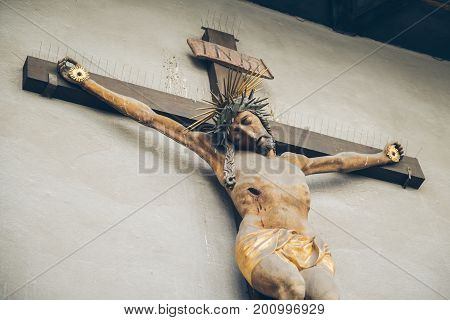 A statue of Jesus on the cross at the wall