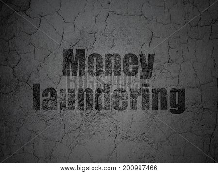 Banking concept: Black Money Laundering on grunge textured concrete wall background