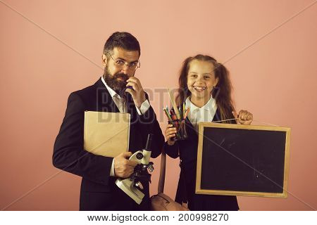 Man And Girl In School Uniform. Home Schooling Concept