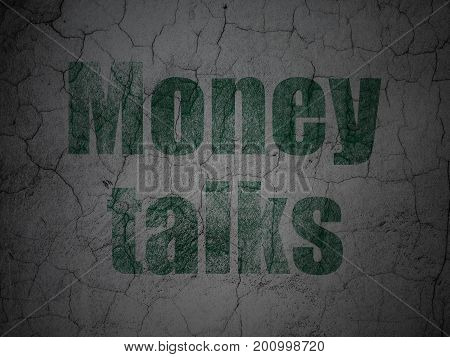 Business concept: Green Money Talks on grunge textured concrete wall background